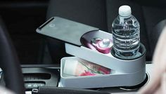 Travelstacks is a set of two stackable plastic containers that wrap around your car's cup holder. Use Travelstacks to store your day's fill of snacks, or as additional car storage for your phone, keys, parking meter change, and loose ends. Car Gadgets, Gadgets And Gizmos, Road Trip Hacks, Road Trips, Camping Hacks, Car Storage, Extra Storage, Drink Holder, Cup Holders