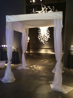 Modern Chuppah with ornamented satin canopy and full organza drapes www.chuppah.ca