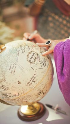 A world globe as a guestbook. Perfect for couples who are known to travel.