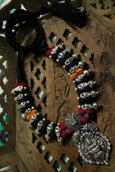 Elegant Thread Necklace Set With Oxidised German Silver Temple Pendant With Earring