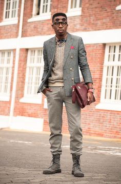 Nail that dapper look with a grey wool double breasted blazer and brown wool dress pants. To break out of the mold a little, go for a pair of charcoal canvas boat shoes.  Shop this look for $410:  http://lookastic.com/men/looks/pocket-square-messenger-bag-cable-sweater-longsleeve-shirt-boat-shoes-sunglasses-watch-dress-pants-double-breasted-blazer/4129  — Neon Pink Pocket Square  — Burgundy Leather Messenger Bag  — Beige Cable Sweater  — Navy Print Longsleeve Shirt  — Charcoal Canvas Boat…