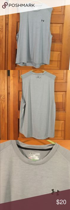 Under Armour muscle Athletic shirt This gray shirt is XL, Loose , & says heat gear. Under Armour Shirts Tank Tops