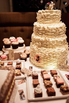 Wedding cake table and selection of treats at Devonshire terrace