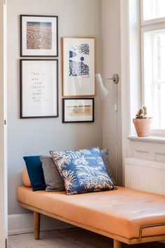 Stylish and comfy daybed corner with cool wall art. Ideal for a small break.