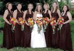Amy and her bridesmaids carry autumn inspired cascades