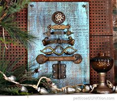 I added the sparkle and rust hardware Christmas tree to the rustic mantel display I shared last week. The turquoise color and the rusty hardware work well with the amber glass pieces.