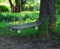 Repurposed Skateboard Swing - I would drill holes and loop the rope through it - I could see the boys hurting themselves as is.