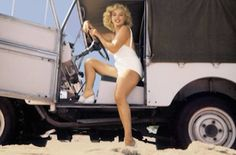 "Marilyn Monroe in 1961 behind the wheel of a Series Land Rover on the Nevada movie set of John Huston's ""The Misfits."""