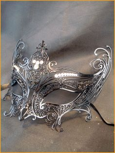 Beautiful silver mask we will attend a masquerade ball one day Maskerade Outfit, Silver Mask, Silver Filigree, Silver Metal, Costume Venitien, Masquerade Ball, Masquerade Theme, Masquerade Wedding, Carnavals