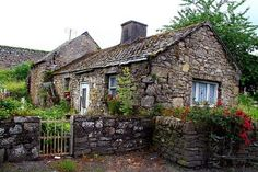 A little stone house beside jerpoint Abbey in Thomastown, Kilkenny, IE. Irish stone cottage