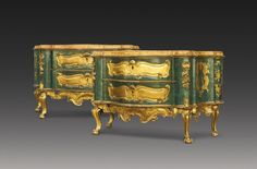 A PAIR OF ITALIAN PAINTED AND PARCEL-GILT COMMODES, VENETIAN CIRCA 1760 each with later faux-marble shaped top above conforming body with two long drawers on a green ground with burnished gilt cartouche panels, the canted corners with carved and gilt flowers and the sides decorated with burnished gilt rococo cartouches, on cabriole legs and claw and ball feet joined by shell carved aprons