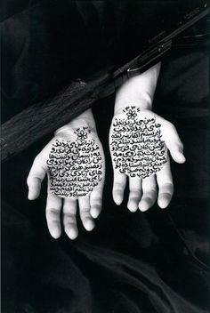 STORIES OF MARTYRDOM, FROM THE 'WOMAN OF ALLAH' SERIES, 1994.By Shirin Neshat, photography, ink on silver gelatin print, and calligraphy