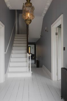 The property is a large double fronted Victorian house, based in Streatham Common, South West London. It has recently been restored and renovated to a beautiful standard, keeping in mind the period in which it was built. It showcases many original period Hallway Colours, Home, Victorian Homes, Victorian Hallway, London House, House Interior, Stairway Lighting, Stairways, Small Hallways