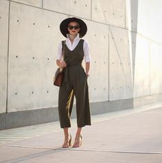 7 chic fashion blogger outfits to copy from this week's best Instagrams: Blair Eadie wears a jumpsuit over a crisp white button down shirt