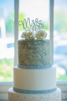 Glitter wedding cake with white roses and Mr & Mrs topper #wedding #cake #Michiganwedding #Chicagowedding #MikeStaffProductions #wedding #reception #weddingphotography #weddingdj #weddingvideography #wedding #photos #wedding #pictures #ideas #planning #DJ #photography