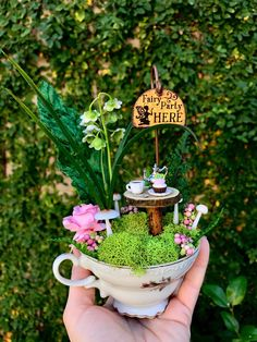 I just had to make a few more tea cup fairy gardens! Included with this little beauty... a vintage tea cup filled with real moss, faux berries, faux leaves and greenery, handmade clay mushrooms and a pretty pink paper rose. Nestled in the moss is a tiny rustic table set with tea for