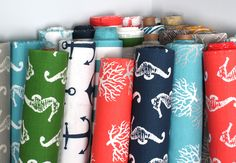 Nautical fabric by Premier Prints including striped, coral, seahorse, anchor and starfish designs. Fabric colors include coral, navy green, grey and turquiose.