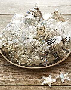 Shimmering Christmas centerpiece with glass & silver ornaments.
