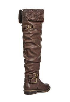 Slouchy and totally comfortable, this over-the-knee boot features multiple straps, a shearling foldover detail, and a buckle strap at the top of the shaft....
