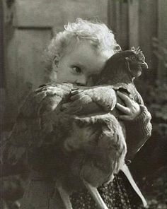 Precious photo of a girl and her favorite hen.