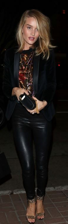 Rosie Huntington-Whiteley: Ring, jacket, and purse – Yves Saint Laurent  Shoes – Brian Atwood  Earrings and ring – Anita Ko