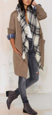 Wool blend cardigan featuring a drape design, open front, pockets, ribbed trim, and chunky knit sleeves.