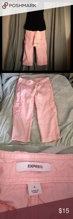 Pink capris cargo pants with ribbon belt Pink capris cargo pants with a ribbon belt. Cuff have cinch laces for a tight look. These would be super cute with black heels or even flats. Dress it up or down. Material is 100% cotton. Size is 6. Express Pants Capris