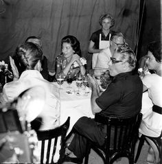 Maria Callas and Aristotle Onassis at a dinner party