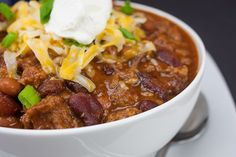 Thick and hearty homestyle chili is the perfect winter warm up meal! It's not a loose soup, it's thick, chunky and loaded with hearty flavor.