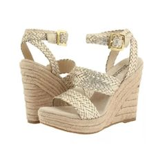 "MIchael kors white gold metallic juniper wedge Braided leather straps compliment a jute-wrapped platform wedge for all-over natural texture. Leather Rubber sole Heel measures approximately 4 1/2"" Platform measures approximately 1"" Michael Kors Shoes Wedges"