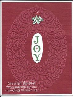 Finally Stampin' Up! has started carrying Core'dinations card stock. This card uses the Cherry Cobbler Core'idinations card stock and the new Holiday Frame Textured Impressions Embossing Folder