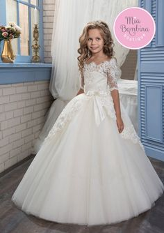 This super elegant Buffalo dress with half-length lace sleeves and scalloped lace edge neckline is the perfect flower girl dress for a wedding day. Beautiful floor length full skirt from the finest tulle features stunning overskirt detail edged with floral lace. A lovely front bow accent complements to the grace of this dress. Additional tulle skirts can be bought to enhance this dress further. Your little princess will be the belle of the ball.