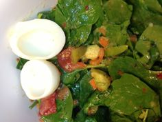 Spinach, avocado, tomatoes, carrots, egg whites, pickles with vinegerette.