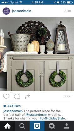 I love the decor on top of this armoire and the wreaths hanging from the doors!