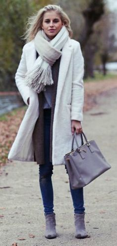 This white coat is ideal for winter walks, and looks great paired with a matching oversized scarf and casual denim jeans. Caroline Daur shows us the perfect mix of sleekness and sophistication in this outfit.   Coat: MSGM, Jeans: Levi's, Bag: Zara, Shoes: Ash. Cute Fall Outfits.... | Style Inspiration