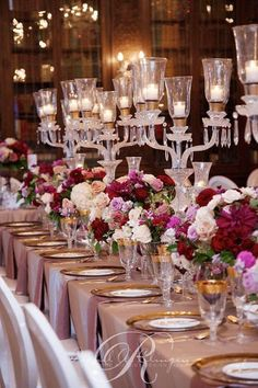 White, pink and red blooms beautifully combine to create elegant centerpieces ~ http://www.modwedding.com/galleries/reception-decor/