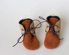 Burnt Orange with Dark Navy Lining.    Made from a 100% wool felted sweater and soft suede, these are a great first walking shoe. Soft and flexible,