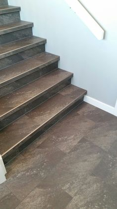 Luxury Vinyl Tile Installed With Custom Insert Stair Nosings. More