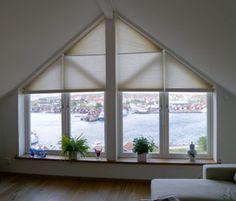 Solskydd för lutande fönster