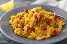 This classic one-pot chicken and prawn paella Spanish dish is not only delicious, but it also saves on the washing-up! Not all traditional paellas use chicken, but we like it better this way. Cooked in just 1hr, this delicious chicken paella recipe serves 4 people.
