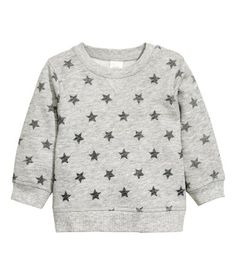 Gray melange/stars. CONSCIOUS. Soft, organic cotton sweatshirt with a printed pattern. Snap fasteners on one shoulder and ribbing at neckline, cuffs, and