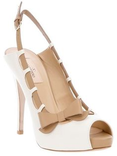 Feminine bow, platform that's 'within reason', neutral tones ... a great shoe for Spring! Valentino ... whether bows or studs, fabulous!