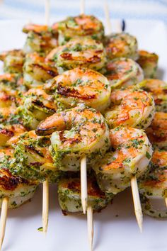 Pesto Grilled Shrimp -I made this with Martha Stewart's recipe for baked lemon rice with herbs -they go perfect together-add a caprice salad and you're set to go..