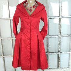 "Moschino Fit and Flare Red Coat Amazing cotton coat with portrait collar.  Large pleats at waist. Side pockets.  Fully lined. 95% cotton 5% spandex  17"" pit/pit, 15"" waist 37"" length. Just dry cleaned, in perfect condition. One button was loose and has been reinforced. Could be worn as a dress.  Very beautiful coat perfect to welcome spring! Moschino Jackets & Coats"