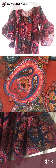 Deep Red Paisley Tunic with Bell Sleeves Tunic features groovy burgundy paisley print and elbow-length bell sleeves. Elastic neckline allows an off-the-shoulder option. Very comfortable. Adorable with leggings! Polyester fabric. NOTE: Although tag is 3X, it is considered size 16-18. One Faith Boutique Tops Tunics