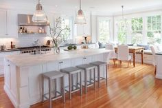 White kitchen, wood accents