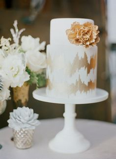 Gold Painted Cake Delight!  Esther Sun Photography | More on SMP: http://www.stylemepretty.com/2012/12/24/gondola-holiday-wedding-shoot-from-esther-sun-photography/