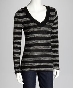 Casually chic, this v-neck top looks lovely in any setting. Flaunting a fitted silhouette and stripe pattern, it makes a staple worth savoring.Measurements (size M): 28'' long from high point of shoulder to hem100% rayonHand wash; hang dryImported