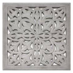 "Add texture to your home décor with the 18""x18"" Carved Wood wall accent. A traditional, floral pattern is intricately carved into this square wood, creating a vintage piece that's great indoors or outside. Finished with a distressed paint, this framed wood accent is a calming touch for any room. It's also a great housewarming gift for a friend."