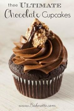 These chocolate cupcakes are so moist with a chocolate ganache center topped and incredibly creamy chocolate frosting. Bakerette.com #recipe #cupcakes by tabby7cat